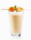An exotic smoothie with mango and kumquats