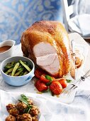 Partly sliced roast turkey, with pancetta stuffing