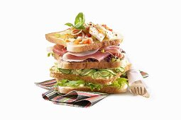 A sandwich stack (toast with cucumber, cured ham and cheese)