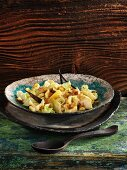 Vanilla spätzle (soft egg noodles from Swabia) with pointed cabbage, pears and hazelnuts