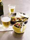 Guacamole with tortilla chips and beer