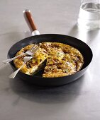 Potato frittata in the frying pan