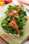Chicken drumsticks on lamb's lettuce