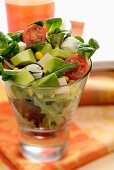 Avocado salad with chicken, cheese, tomatoes, rocket and lamb's lettuce