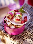 Pancakes stuffed with raspberries for a picnic