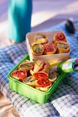 Pancake rolls with tomatoes and courgette for a picnic