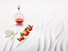Strawberries cooked 'sous vide' with woodruff meringues and black pepper