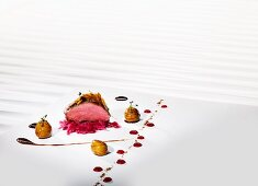 Saddle of venison cooked 'sous vide' with red cabbage and chestnuts