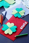 Invitation cards decorated with origami four-leafed clovers