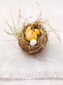 An Easter nest with a fondant chick and sugar eggs