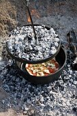 A colourful pizza cooked in a Dutch oven