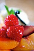 Pancakes with peaches, raspberry and lemongrass (close-up)