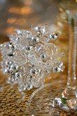 A crystal Christmas decoration on a table