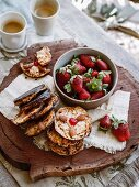 Florentines with fresh strawberries and coffee