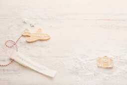 Biscuits shaped like an aeroplane and a suitcase