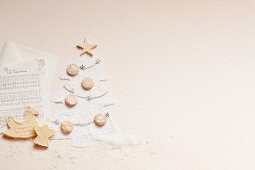 Sheet music, biscuits and a Christmas tree made from icing sugar