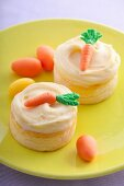 Mini cheesecakes with vanilla custard and marzipan carrots