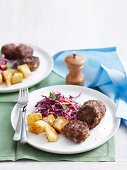 Beef rissoles with potatoes and coleslaw