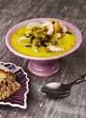 Saffron soup with fish and prawns