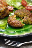 Vegetable and bulgur wheat burgers with tomato salad