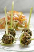 Balls of tuna tartare on lemon grass skewers