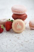 Assorted macaroons with fresh strawberries