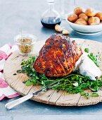 Glazed roast ham studded with cloves