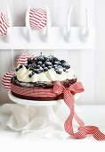 Flourless chocolate cake with cream and berries