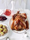 Stuffed turkey wrapped in bacon with cranberry chutney