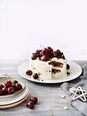 Coconut and chocolate ice cream cake with cherries