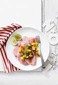 Ham with mango salsa and lime