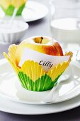 Apple in paper cake case as place card holder