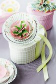 Paper flower made from paper cake cases decorating gift box