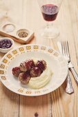 Kötbular (Swedish meatballs) with cranberry sauce and mashed potatoes