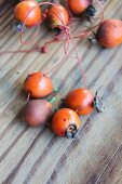 Rosehips threaded onto a string