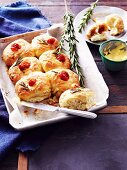 Australian rolls with cheese, cherry tomatoes and rosemary