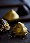 Golden pyramid chocolates