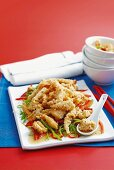 Deep-fried squid on a bed of peppers and sugar snap peas (China)