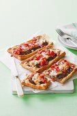 Puff pastry tarts with lamb and tomato salsa