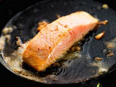 Salmon fillet cooking in butter/step shot