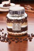 Assorted ingredients for coffee in a screw-top jar as a gift
