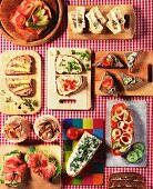Slices of bread with various toppings on small boards