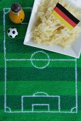 Sauerkraut with a German flag and football-themed decoration