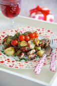 Fried potatoes with sausages and cherry tomatoes