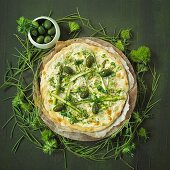A green and white pizza