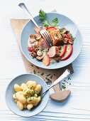 Pork medallions with sliced apple and mushrooms, served with gnocchi