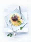 Baked pineapple and coconut with a scoop of chocolate ice cream