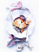 Mascarpone pancake pieces with stewed plums