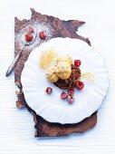Profiteroles with tonka bean & chocolate cream and raspberries