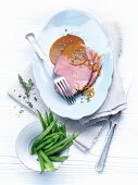 Roasted kid with fragrant orange sauce and green beans